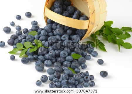 detail of the blueberries spilled from the basket - stock photo