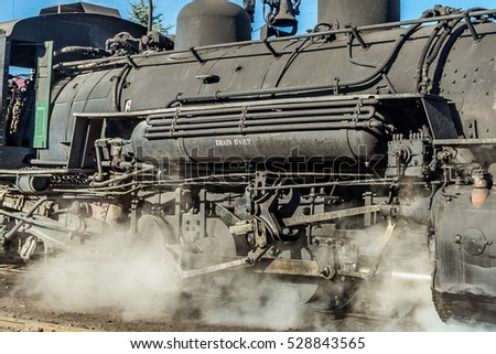 Detail of the boiler, wheels, and running gear of a steam locomotive