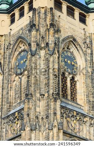 Detail of the clock tower of the Metropolitan Cathedral of Saints Vitus, Wenceslaus and Adalbert. Prague. Czech Republic. - stock photo