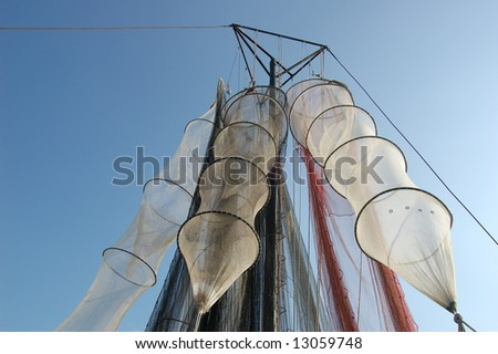Detail of the colourful fishing nets and fish-traps hanging drying in sun and wind - stock photo