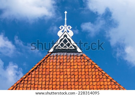 Detail of the decorated roof of an ancient frisian Dutch farm - stock photo