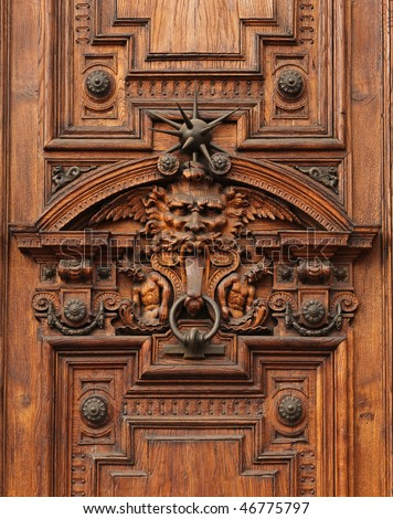 Detail of the door of an ancient rich palace - stock photo