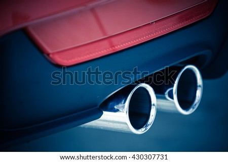 Detail of the double exhaust of a car - stock photo