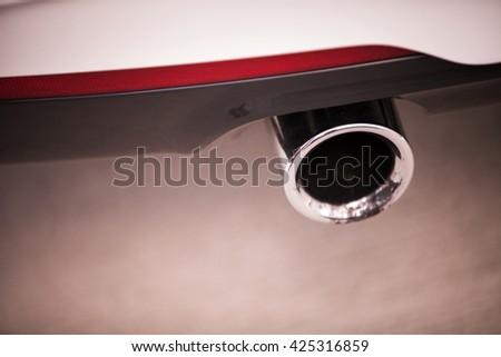 Detail of the exhaust of a car. - stock photo