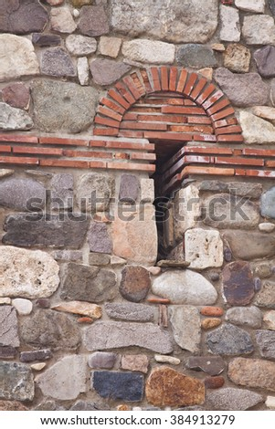 Detail of the exterior fortified medieval stone wall - stock photo