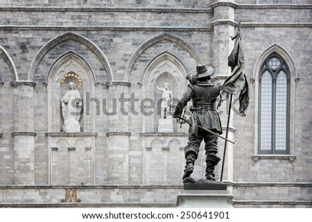 Detail of the exterior of the Basilica Notre Dame, with statue of Paul de Chomedey de Maisonneuve, founder of Montreal. In Old Town, Montreal, Canada. - stock photo