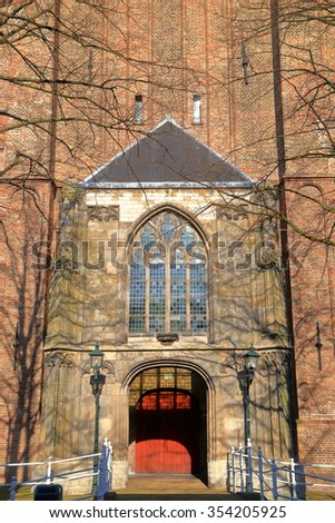 Detail of the facade and door to the Oude Kerk (Old Church), a Gothic Protestant church in the old town of Delft, the Netherlands - stock photo