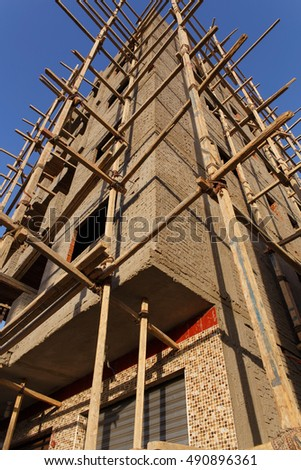 Detail of the facade of a building under construction with scaffolding in Egypt