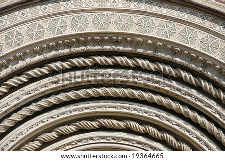 Detail of the facade of Orvieto Cathedral. (1290 - 1600 a. c.) Richly decorated with lots of stone mosaics and reliefs as well as pattern and artistic coils all over the facade.
