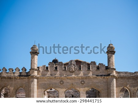 Detail of the facade of the ancient ruined castle, the ancient European architecture - stock photo
