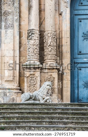 Detail of the facade of the church of San Sebastiano with columns and a marble lion in Palazzolo Acreide, Siracusa, Sicily, Italy