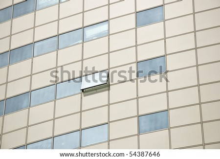 Detail of the facade office building. Aluminum panel and stained glass. One window is open. Outdoor. Close up. - stock photo