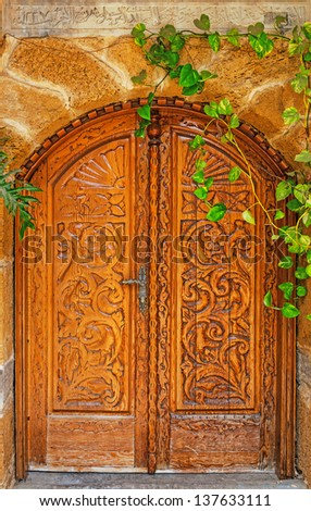 Detail of the Facade with Wooden Door in Jaffa, Israel - stock photo