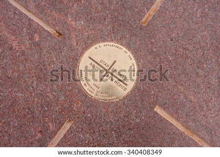 Detail of the Four Corners Monument. The bronze disk marks the quadripoint in the Southwestern United States where the states of Arizona, Colorado, New Mexico, and Utah meet. - stock photo