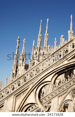 Detail of the gothic Milan Cathedral in Piazza del Duomo. It is the fourth largest church in the world. The construction started in 1386 and took about five centuries. - stock photo
