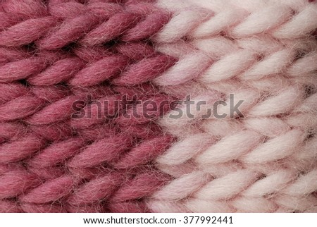 detail of the handmade knitted pattern (two shades of pink) of wool winter yarn - stock photo