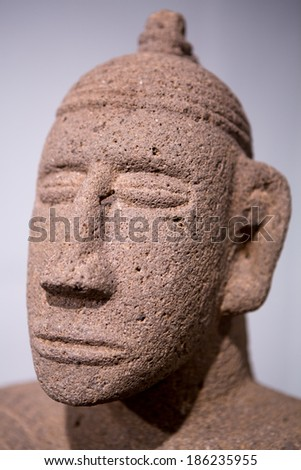 Detail of the head of a Mayan sculpture found in Costa Rica. Ancient Maya art refers to the material arts of the Maya civilization. - stock photo
