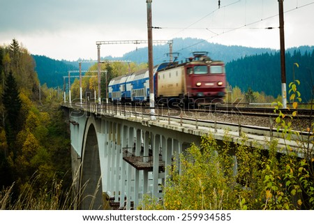Detail of the Karako Viaduct in Harghita county, Romania, a train is passing on it. - stock photo