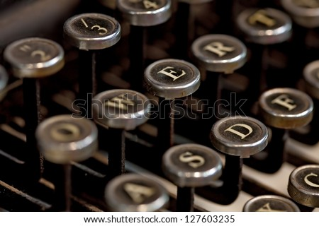 Detail of the keyboard of a vintage typewriter. Useful as communication or office concept. - stock photo