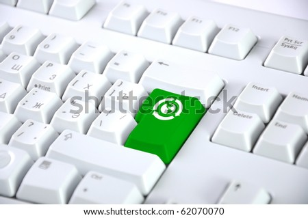 Detail of the keyboard with color key - stock photo