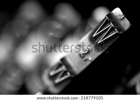 detail of the letter W of very old typewriter - stock photo
