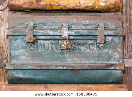 Detail of the lock of an old metal  treasure chest. - stock photo
