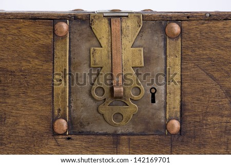 Detail of the lock of an old wooden Chest. Horizontal. Old Lock - stock photo