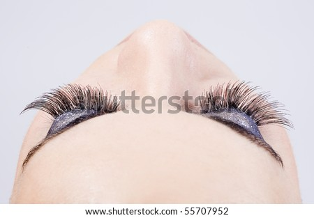 detail of the make up of eyelashes in a young beautiful girl - stock photo