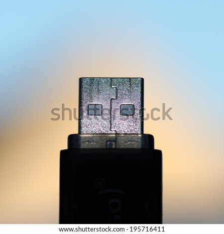 Detail of the metallic connection of an thumb drive. - stock photo