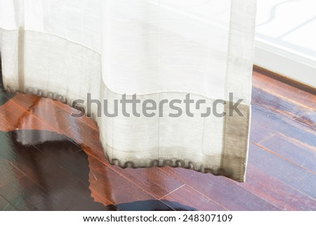 Detail of the modern parquet floors  and curtain. - stock photo