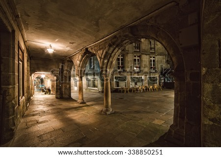 Detail of the old town in Santiago de Compostela at night. Photo shows old architectural arcade.