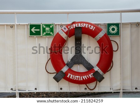 Detail of the red safety lifebuoy from a passenger ferry in Kristiansand, Norway - stock photo