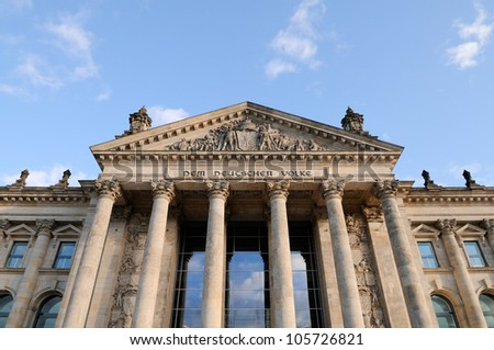 "Detail of the Reichstag building in Berlin with the famous sign ""Dem deutschen Volke""."