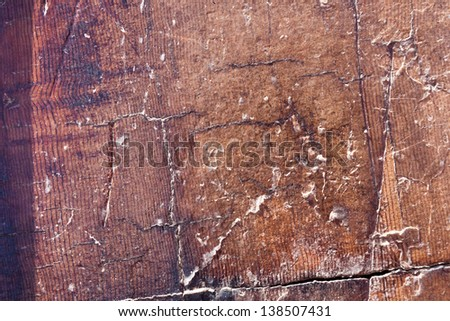 Detail of the rings on a sequoia tree stump with what looks like peeling varnish.