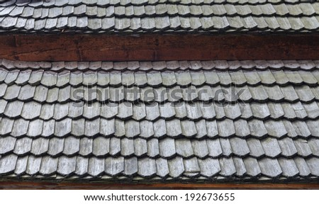 Detail of the roof covered with shingles - stock photo