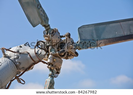 Detail of the rudder propeller of the helicopter against the blue sky
