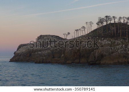 Detail of the San Nicolas Island in Lekeitio Basque Country with end of sunset - stock photo