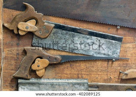 Detail of the set of various old and used hand saws - stock photo