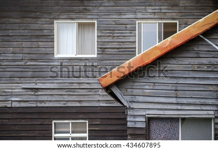 Detail of the side facade of a traditional wooden house - stock photo