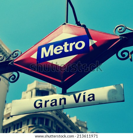 detail of the sign of Gran Via metro station in Madrid, Spain, with a retro effect - stock photo