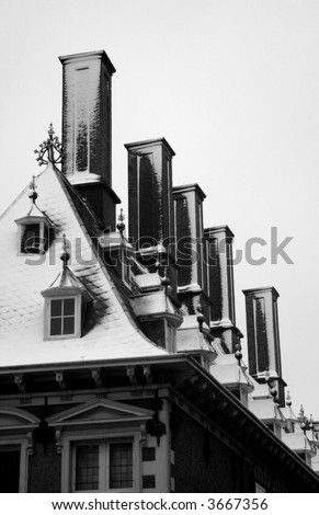 Detail of the snow covered rooftop and chimneys of Haarlem's Town Hall