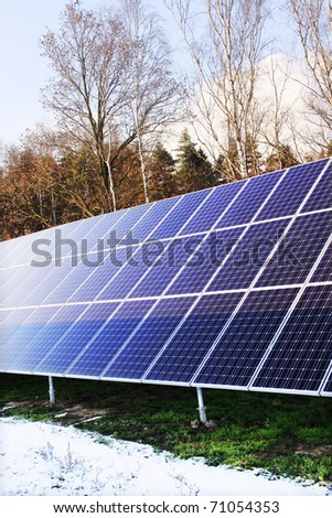 Detail of the Solar Power Station in the snowy Nature - stock photo