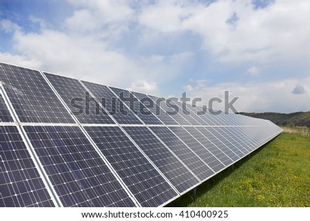 Detail of the Solar Power Station on the spring flowering Meadow  - stock photo