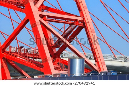 Detail of the span of the metal red bridge  - stock photo