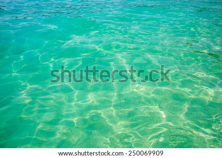 detail of the surface of a tropical vibrant sea - stock photo