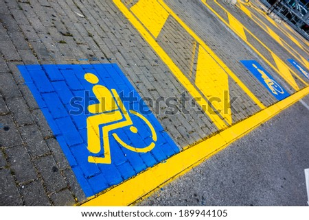 detail of the symbols painted on a disabled reserved parking lot - stock photo