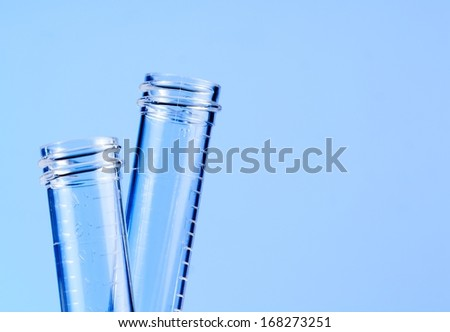 detail of the test tubes in laboratory on blue light tint background - stock photo