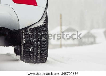 Detail of the tire on winter road - stock photo