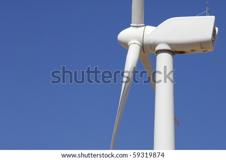 detail of the top of a windmill with blue sky - stock photo