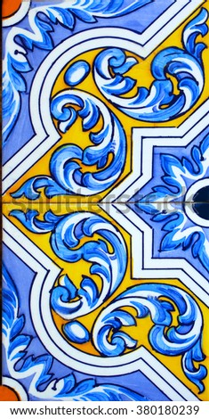 Detail of the traditional tiles from facade of old house. - stock photo